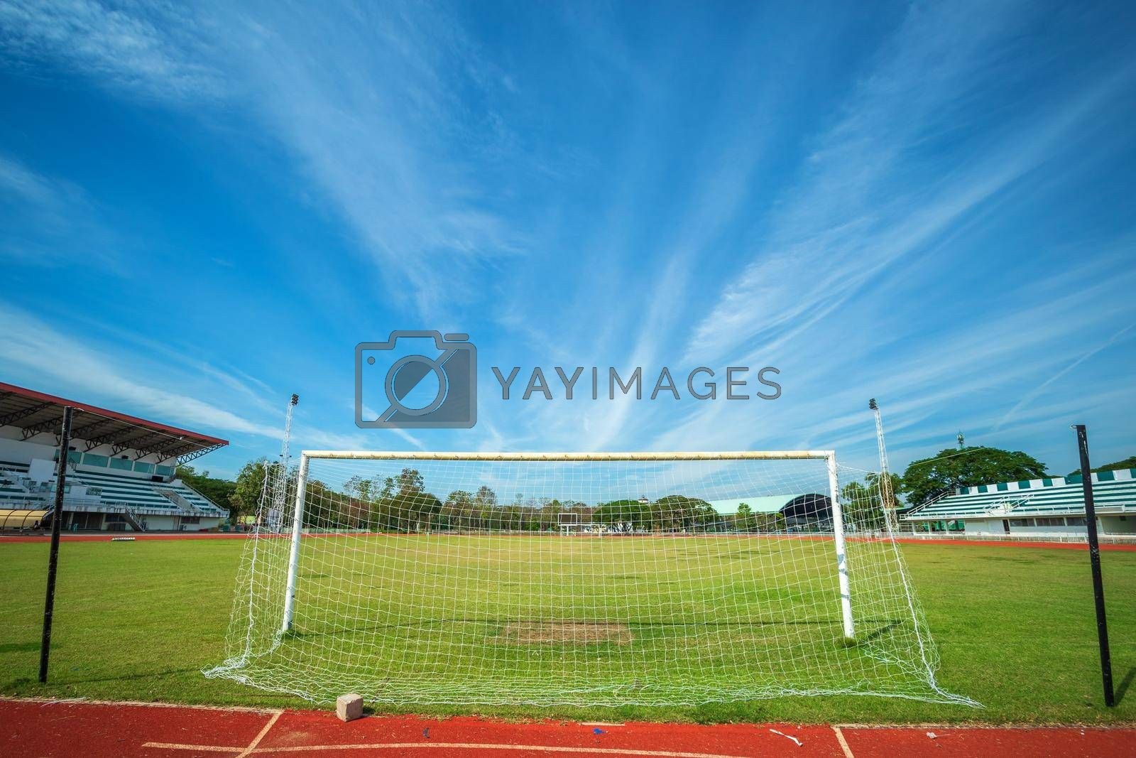 Royalty free image of Stadium Soccer goal or football goal at of stadium with blue sky background. by tinapob2534