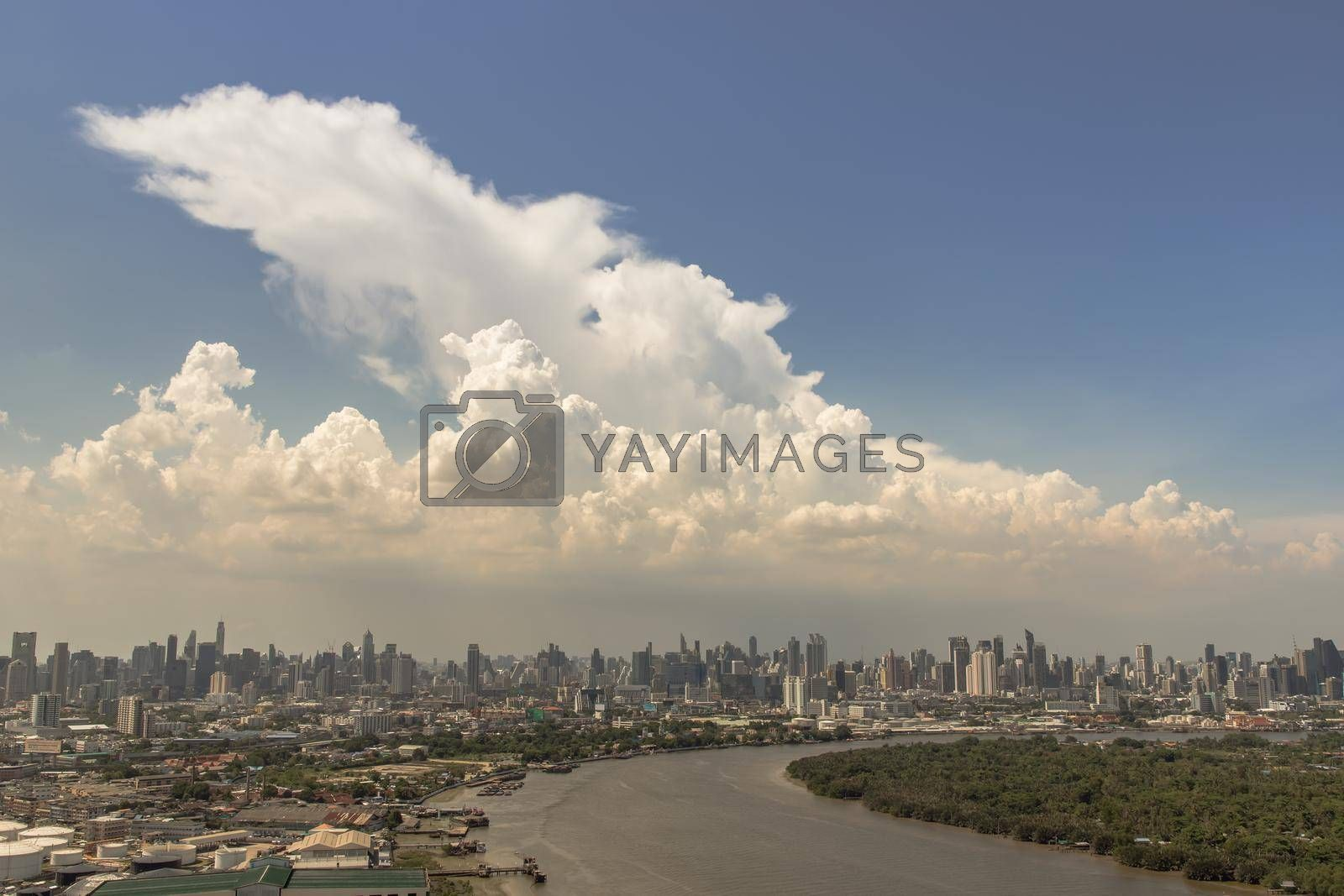 Bangkok, Thailand - Jun 03, 2021 : Beautiful curve of the chao phraya river in the afternoon time. Good time of the day, Nice city view, Selective focus.