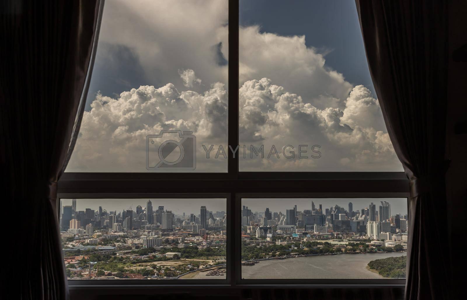 Bangkok, Thailand - 03 Jun, 2021 : Beautiful City with River view at afternoon. Can see through glass windows in the bedroom at bangkok. Selective focus.