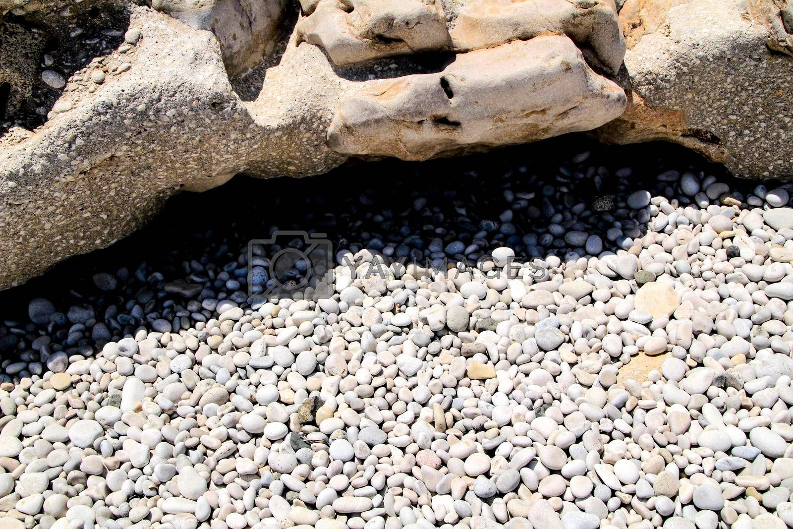 Rocks and pebbles texture on Cap Negret beach in Altea, Alicante, Spain