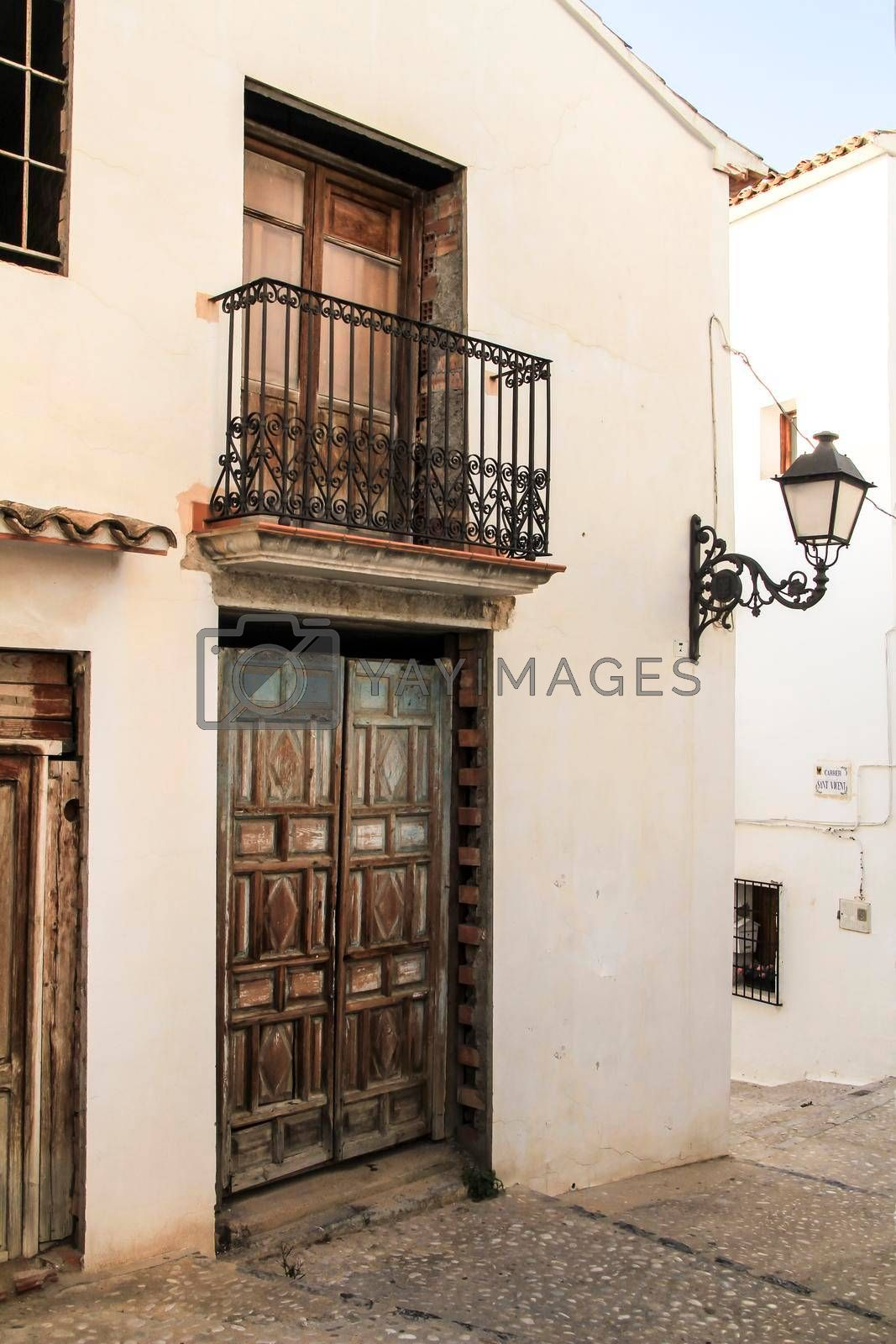 Narrow streets and beautiful whitewashed facades with vintage streetlight in Altea village, Alicante, Spain