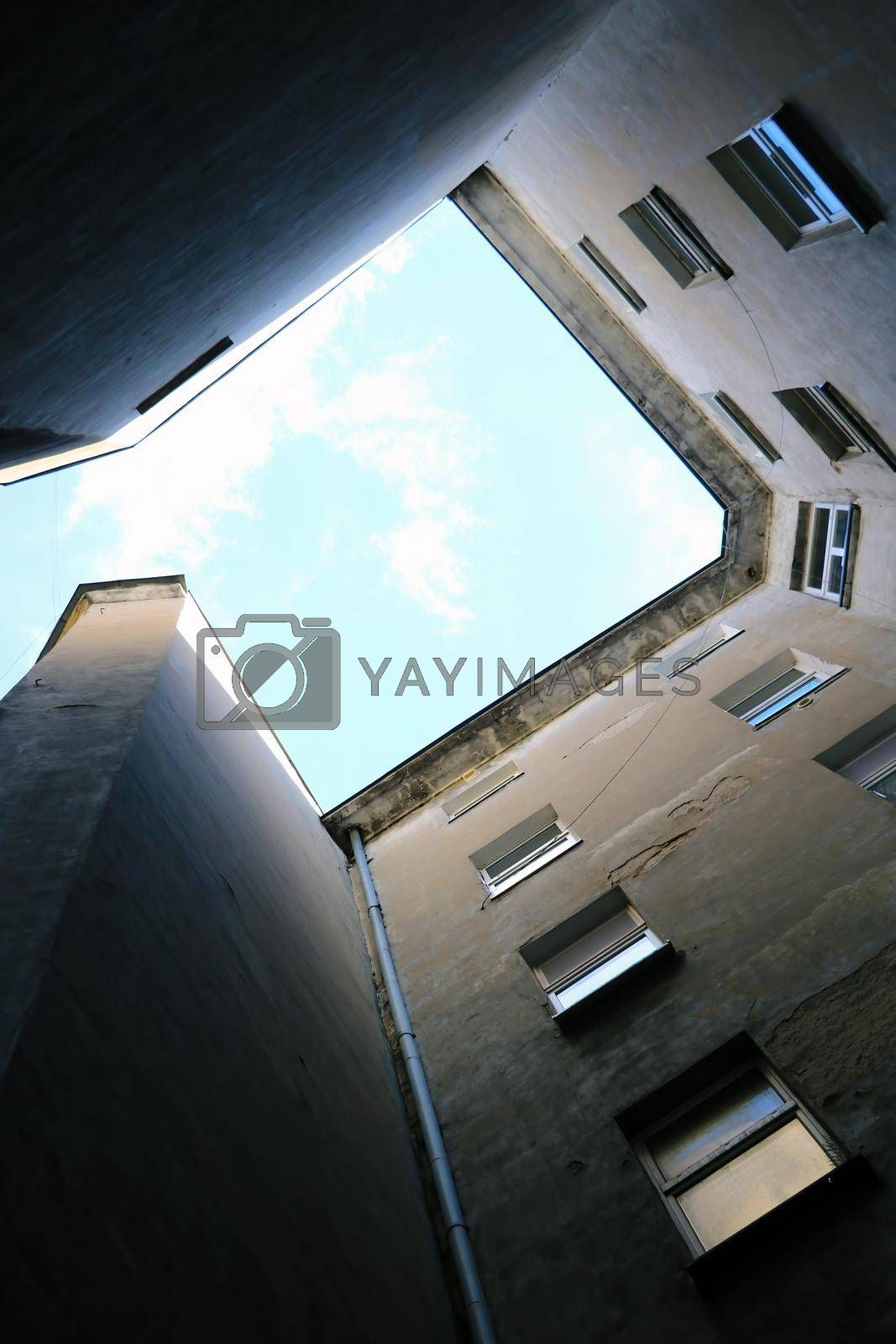 Royalty free image of Bottom to top view in the courtyard of the house. by kip02kas