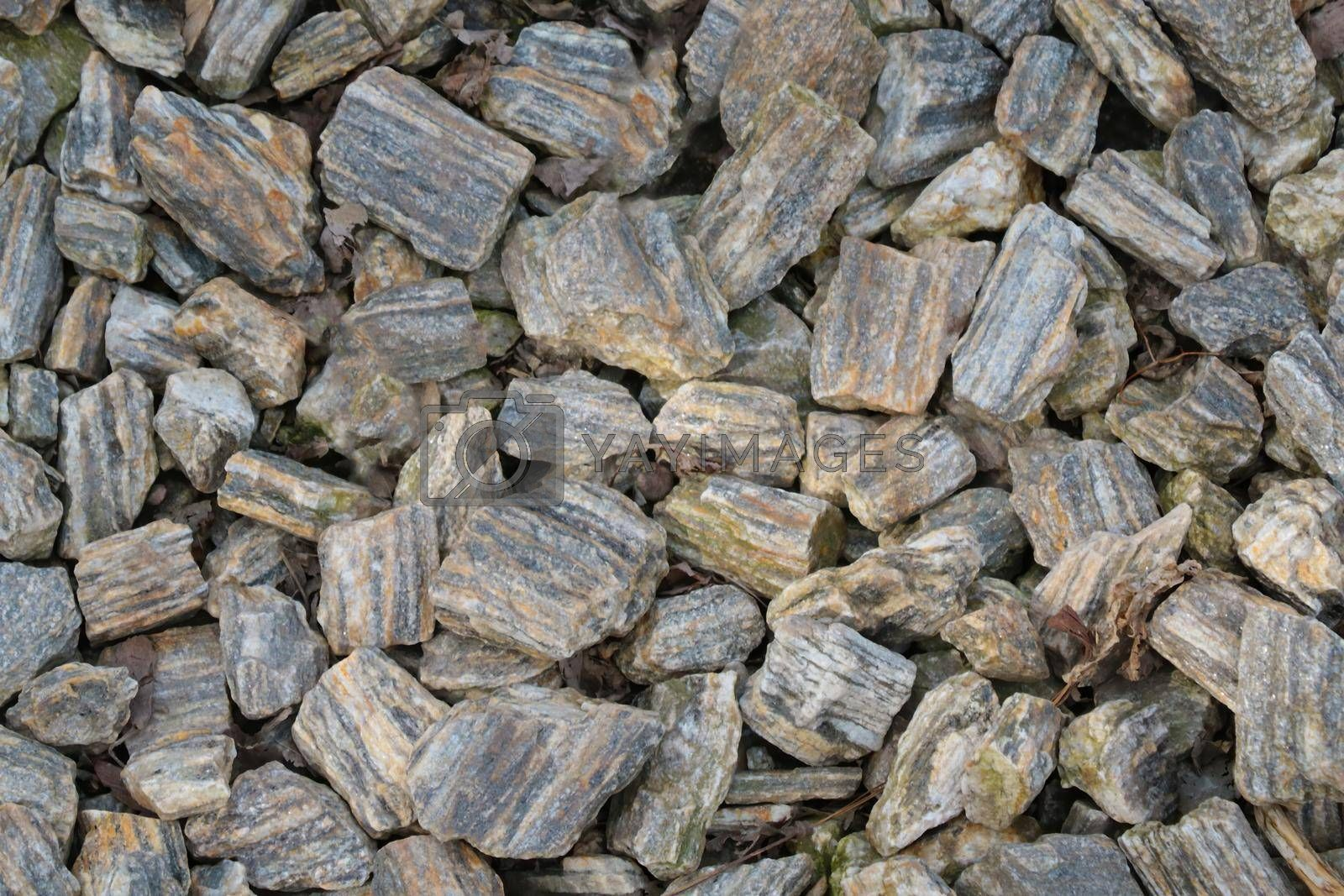 Royalty free image of Top view of small pieces of rock on the ground. Background, texture of stone. by kip02kas