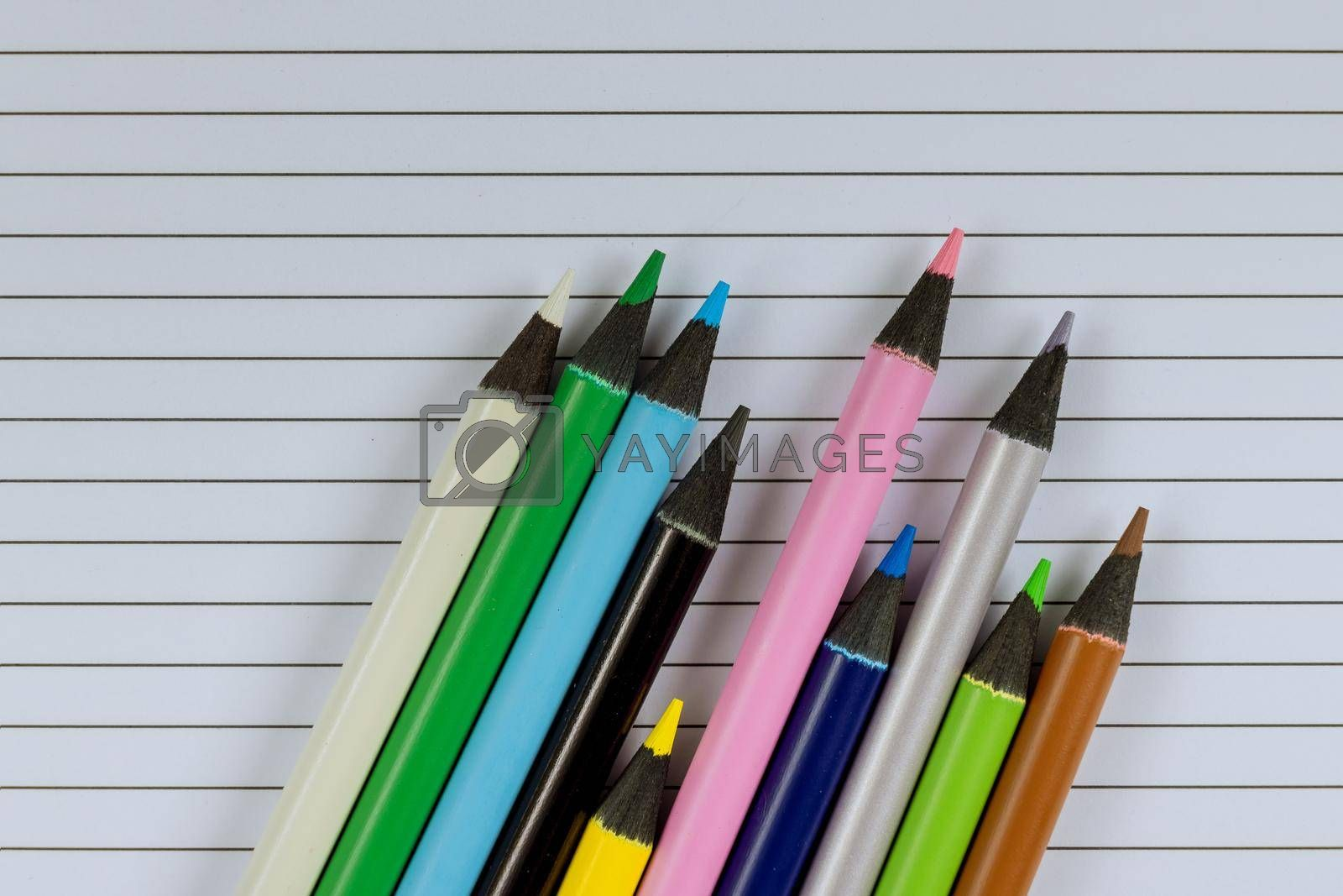 School times in assortment of various school supplies items on stationery equipment