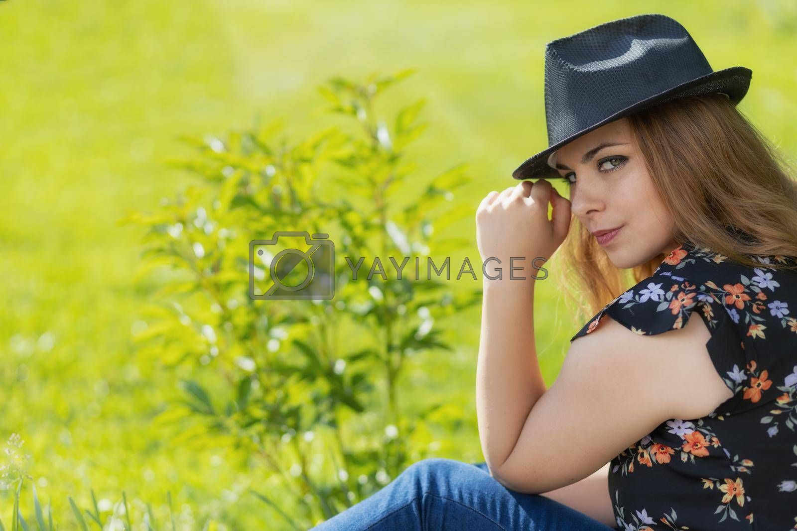 Royalty free image of Portrait of attractive beautiful young woman in black hat. by Frank11