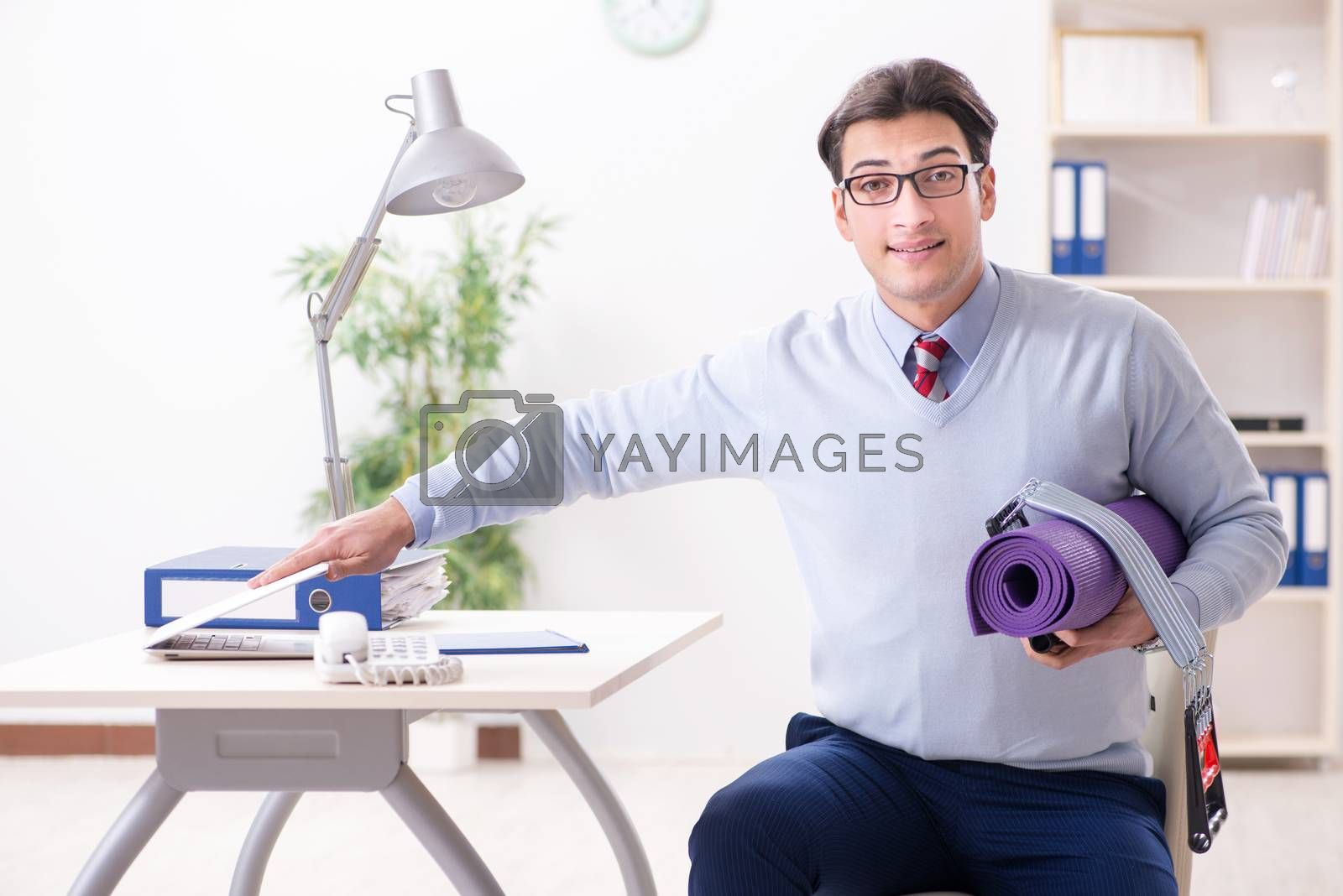 Businessman rushing to gym during lunch break