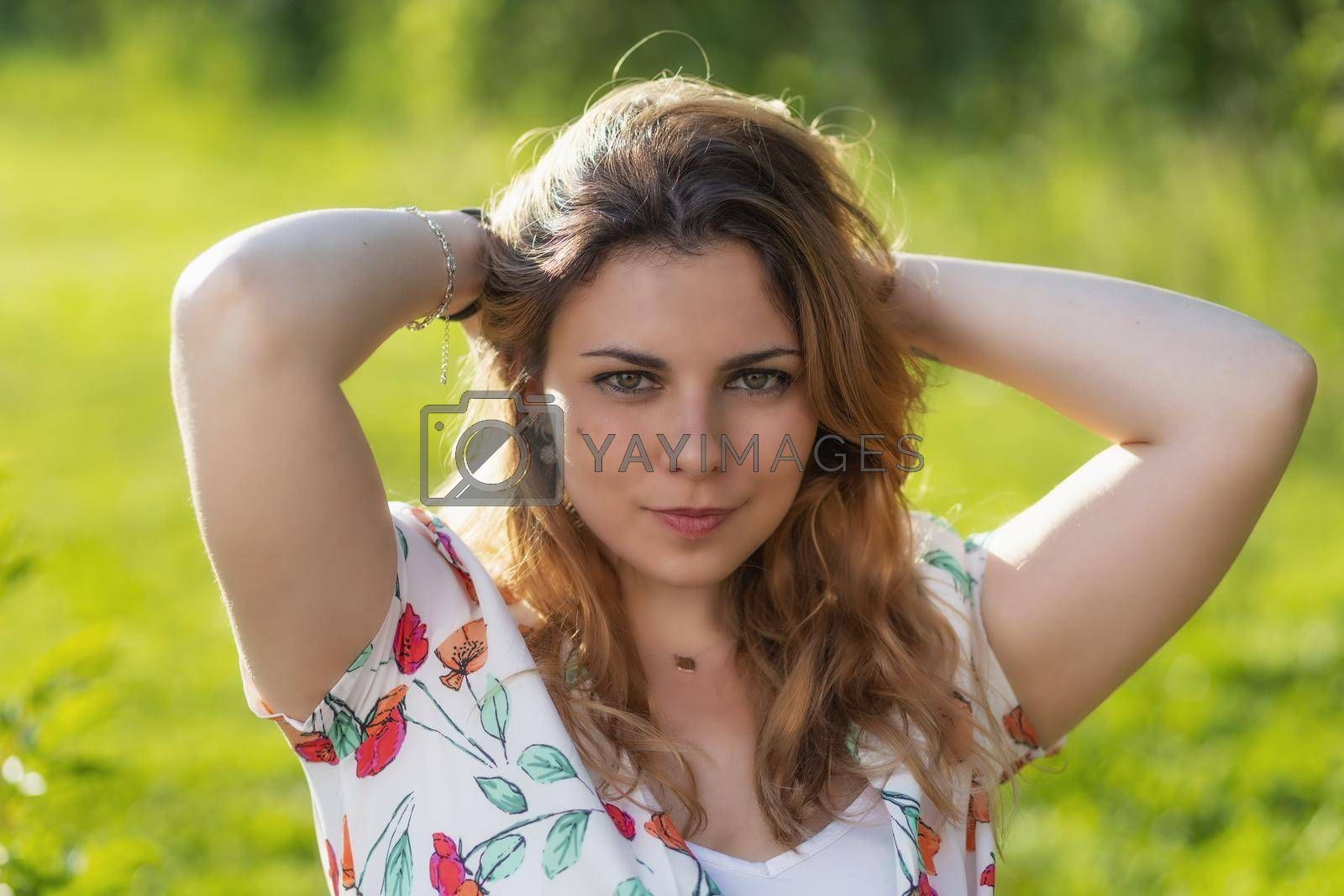Royalty free image of Atractive beautiful  young woman is posing outdoors. by Frank11