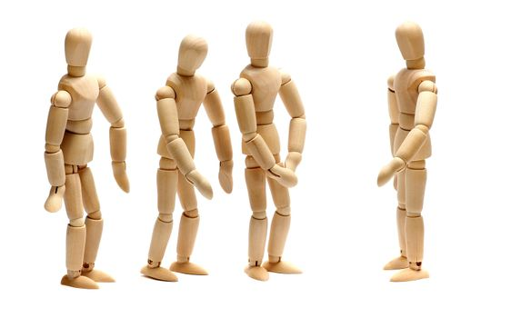 employer and team of wooden dolls
