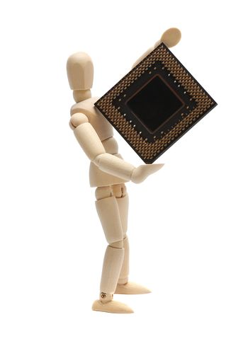 wooden doll holding semiconductor
