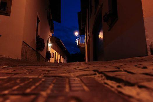 Italian village at night - peble stone road