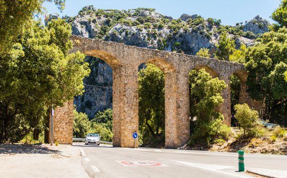 Old stone bridge above highway in Mallorca Spain