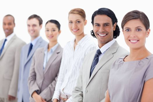 Close-up of smiling business people with focus on the second man against white background