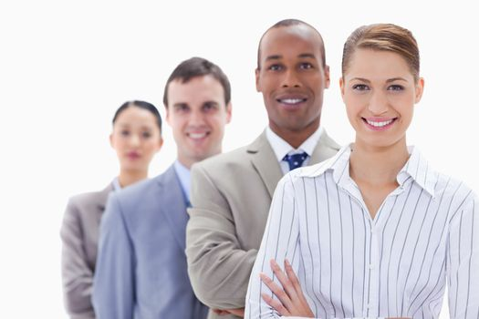 Close-up of a business team smiling in a single line with focus on the first woman