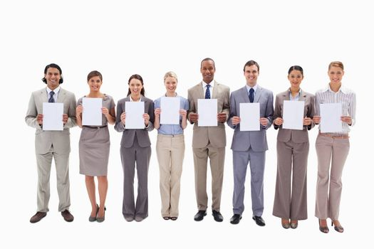Eight business people holding white support for letters against white background