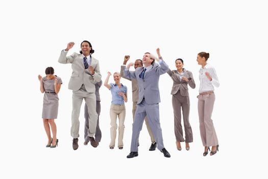 Very happy business people jumping against white background