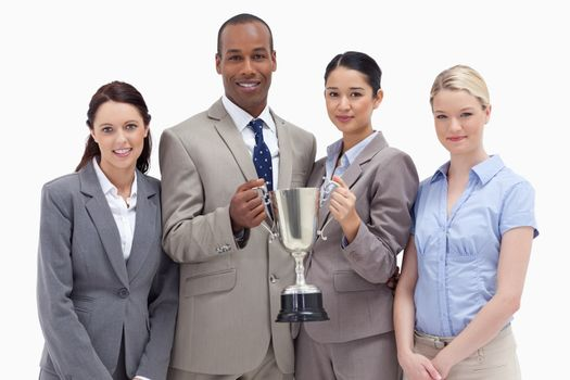 Close-up of a business team holding a cup against white background
