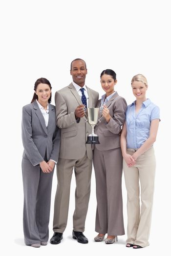 Business team holding a cup against white background