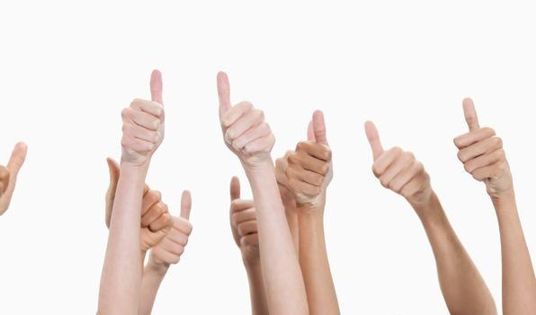 Thumbs raised and hands up against white background