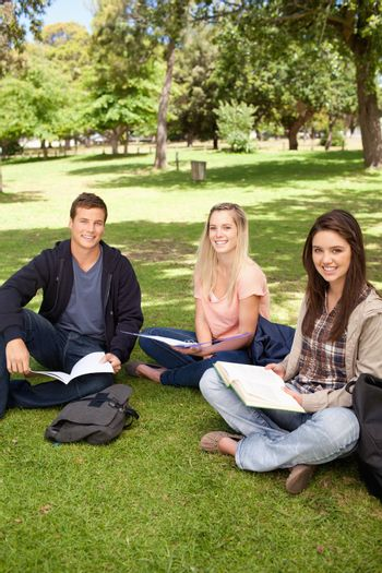 Portrait of young people working in a park