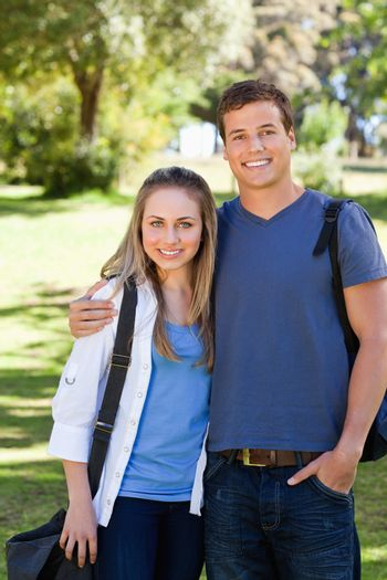 Portrait of a student couple in a park