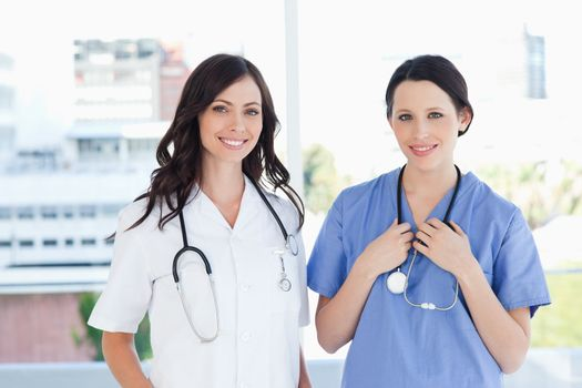 Medical interns standing upright in their short sleeve uniforms
