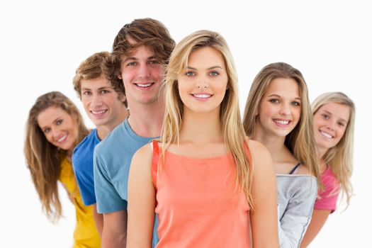 Smiling group standing behind one another at various angles