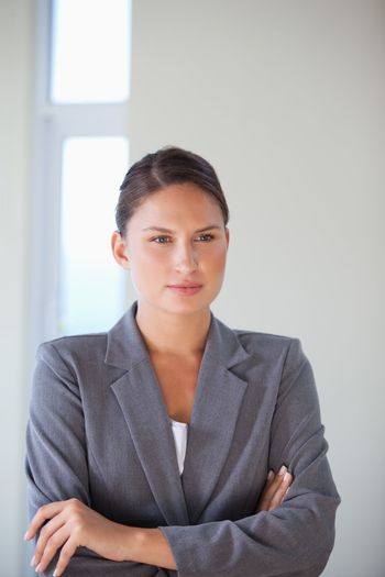 Businesswoman crossing arms