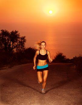 Woman run along the road