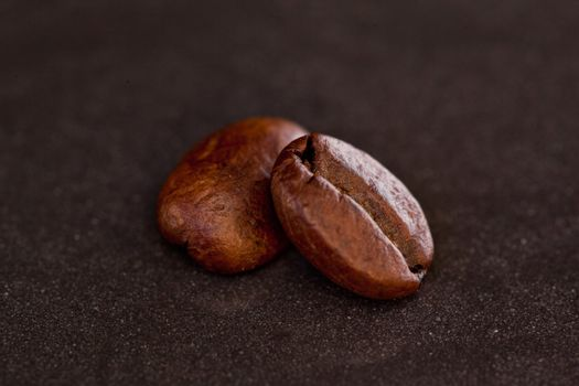 Two coffee beans side by side