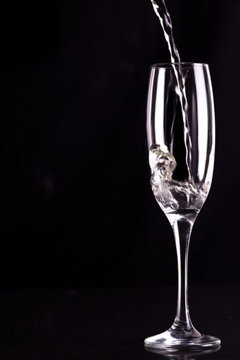Empty champagne flute being filled