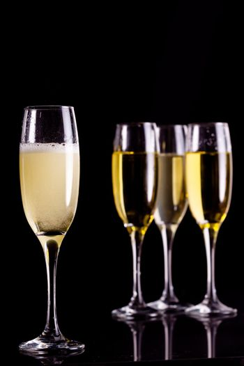 Four full flutes of champagne