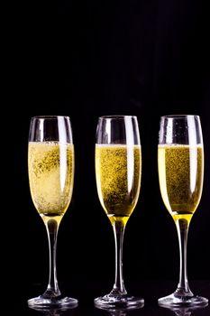 Three full glasses of champagne