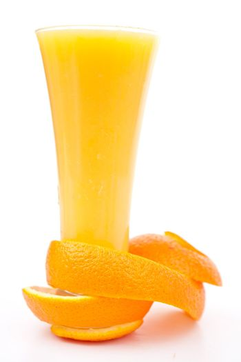 orange peel at the base of a glass