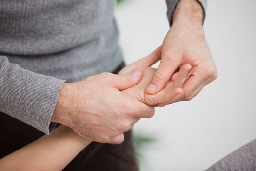 Physiotherapist massaging a hand