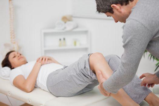Physiotherapist massaging a calf