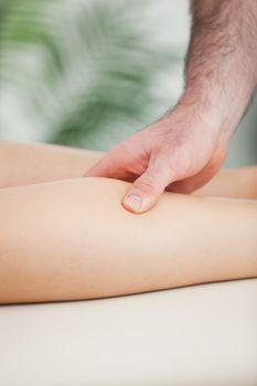 Close up of a man massaging the calf of a woman