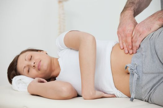 Peaceful woman being massaged by her practitioner