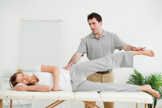 Physical therapist checking the pelvis of a woman