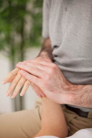 Doctor rubbing the hand of a patient