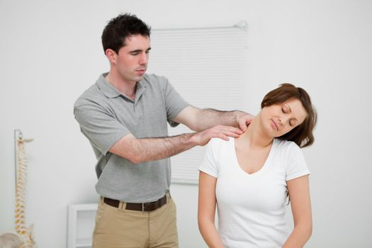 Practitioner looking at the neck of a patient