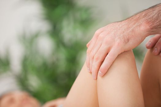 Legs being held by a practitioner
