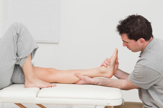 Calf of a patient being massaged by a physiotherapist