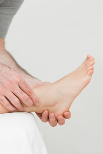 Ball of a foot being held by a practitioner