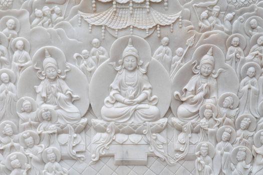 Buddha on marble wall