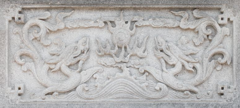 Two dragons on carve wall