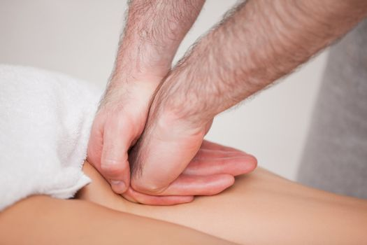 Practitioner massaging the thigh of his patient