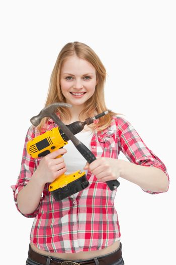 Young woman holding tools