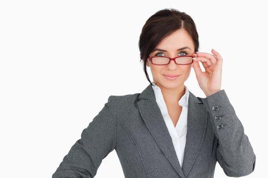 Seductive businesswoman holding her glasses