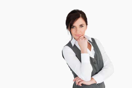 Seductive businesswoman posing
