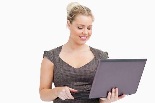 Woman browsing on a laptop